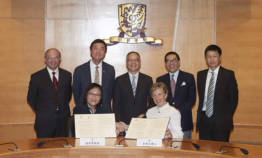 <p>Professor Poon Wai-yin &nbsp;(left, front row), Pro-Vice-Chancellor, The Chinese University of Hong Kong (CUHK), and Dr Trisha Leahy BBS (right, front row), Chief Executive, Hong Kong Sports Institute (HKSI), sign the MOU, with the signatures witnessed by The Hon Lau Kong-wah JP (middle, back row), Secretary for Home Affairs,&nbsp; Mr Yeung Tak-keung JP (1<sup>st</sup> &nbsp;from right, back row), Commissioner for Sports, Professor Joseph Sung SBS JP (2<sup>nd</sup> from left, back row), Vice-Chancellor and President, CUHK, Professor Michael Hui (1<sup>st</sup> from left, back row), Pro-Vice-Chancellor, CUHK, and Mr Carlson Tong SBS JP (2<sup>nd</sup> from right, back row), Chairman, HKSI and University Grants Committee.</p>