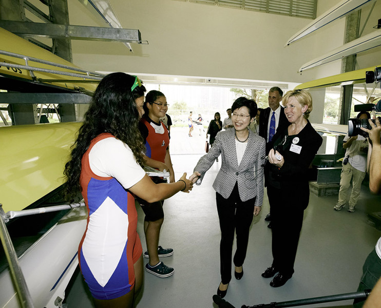 <p>Dr Trisha Leahy (1<sup>st</sup> from right), Chief Executive of the Hong Kong Sports Institute (HKSI) introduced young rowers to Mrs Carrie Lam GBS JP (3<sup>rd</sup> from right), Chief Executive for Administration at the newly completed Rowing Boathouse of the HKSI.</p>