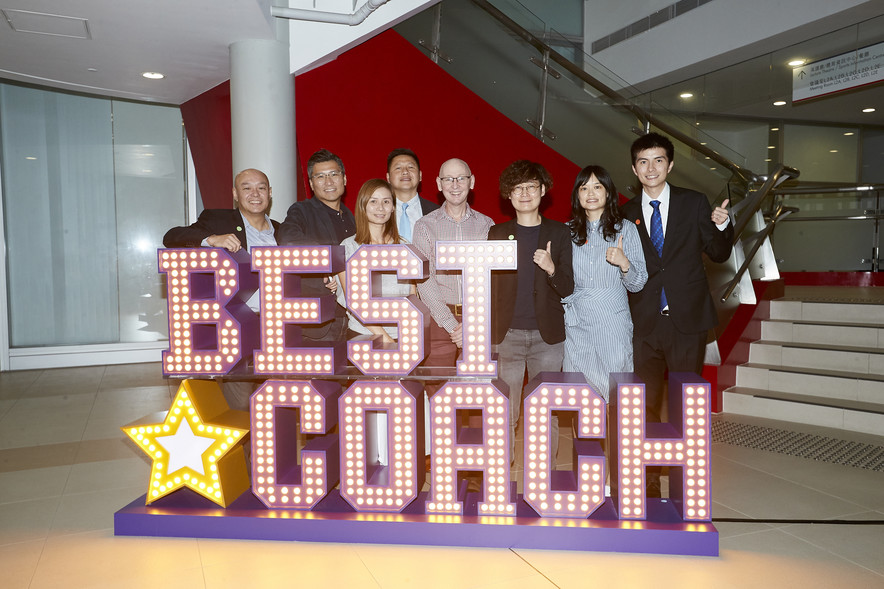 "<p>The officiating guests and coaches captured memorable moments of the event by taking photos at the giant standee of ""Best Coach"".</p>"