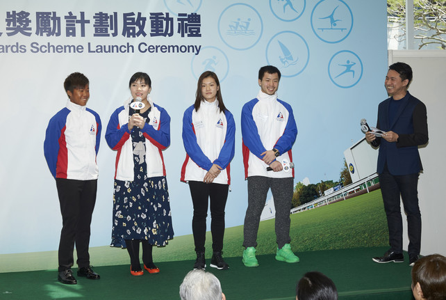Badminton players Lee Chun-hei (2nd right) and Chau Hoi-wah (3rd right), windsurfer Lo Sin-lam (1st left) and wheelchair fencer Yu Chui-yee (2nd left) are encouraged by the Jockey Club Athlete Incentive Awards Scheme.